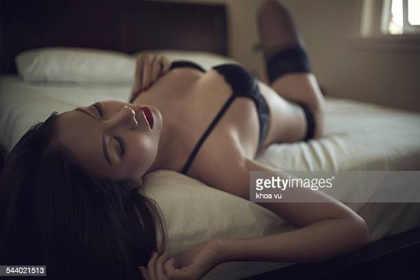 Wearing black lingerie in bed