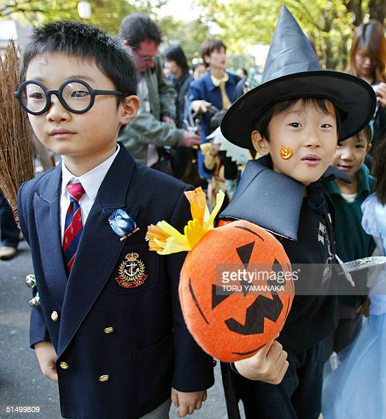 Wearing costumes of Harry Potter and a wizard Japanese kids march on a street in Tokyo's Omotesando fashionable district during the Halloween Pumpkin...