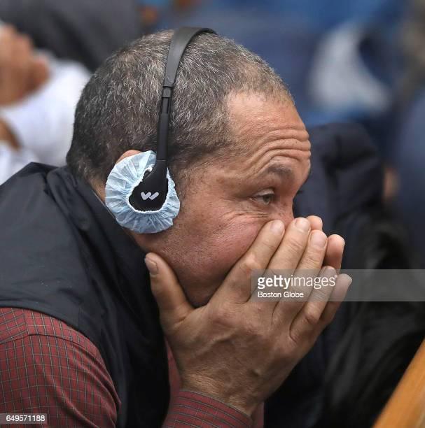 Wearing earphones for translation Ernesto Abreu father of victim Daniel de Abreu listens during the questioning of Sergeant Detective Daniel Duff The...