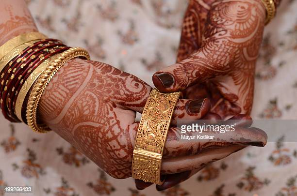 Wearing gold bangle