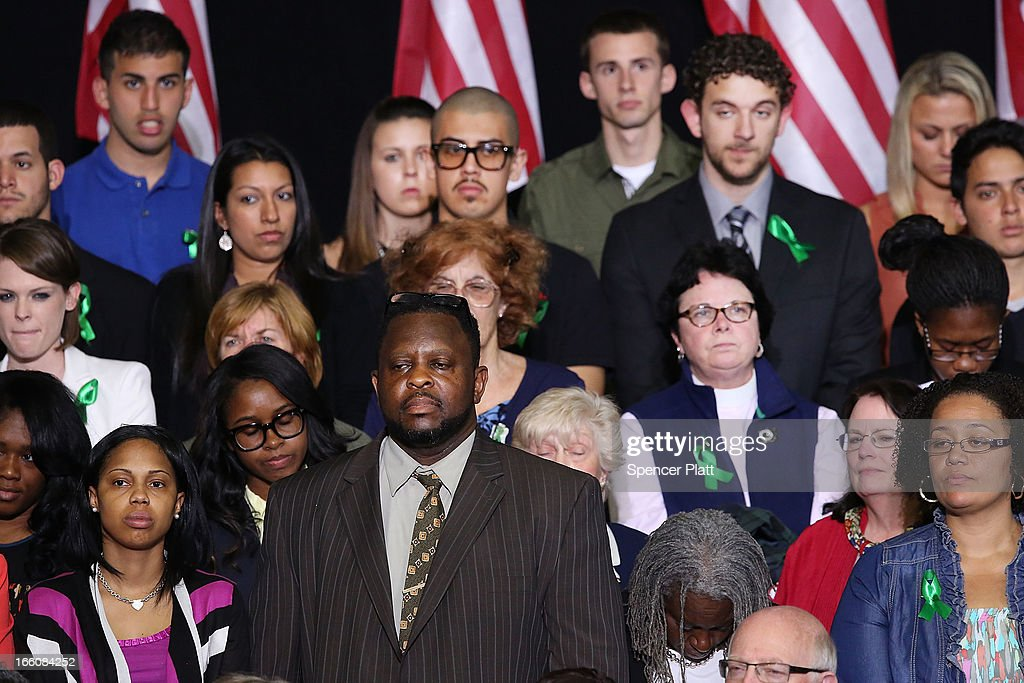 Wearing green ribbons in solidarity with the families of the Sandy Hook shooting victims, audience members listen as U.S. President Barack Obama delivers a speech on gun control at the University of Hartford on April 8, 2013 in West Hartford, Connecticut. Nearly four months after the Sandy Hook Elementary School shootings, Connecticut has passed some of the toughest gun control measures in the nation.