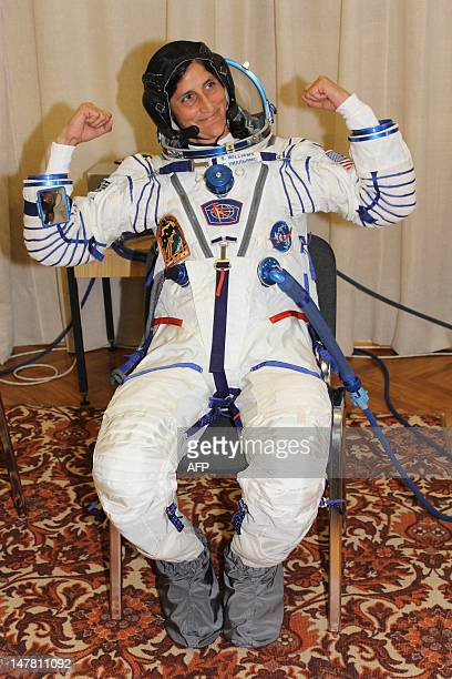an astronaut in her space suit weighs 300 - photo #39