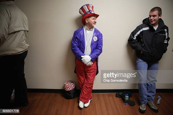 Wearing his homemade sequined Uncle Sam outfit Tim Beverly of Amherst VA waits in line to see Republican presidential candidate Donald Trump deliver...