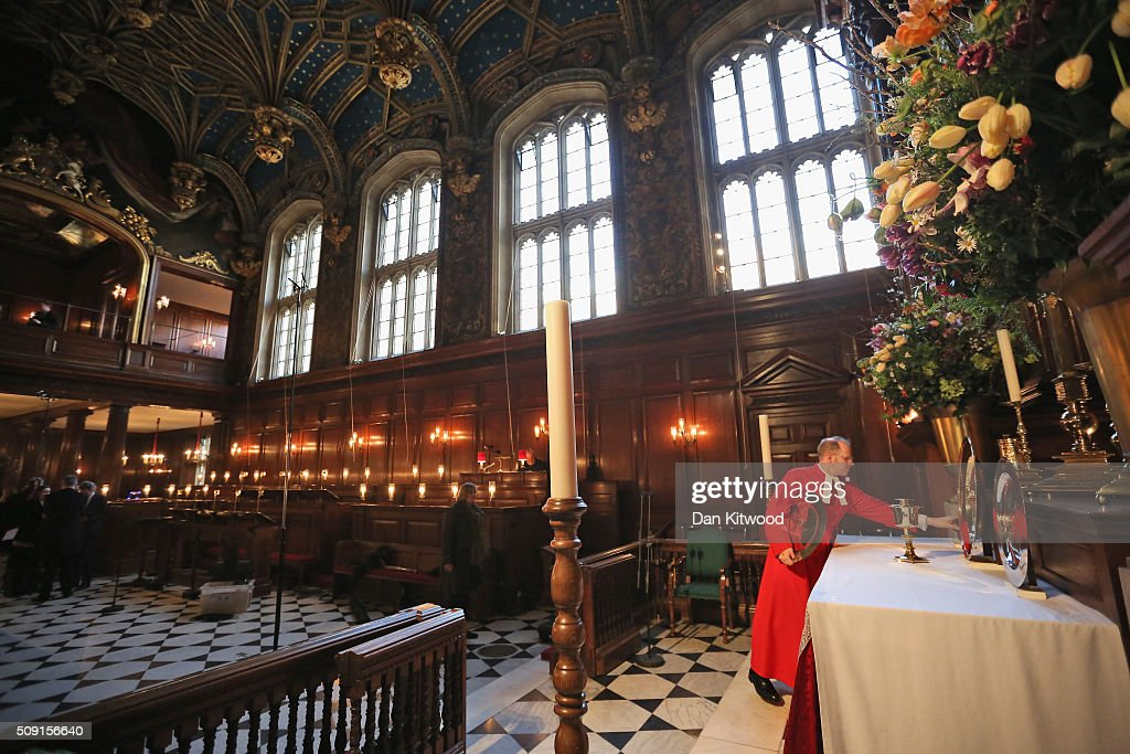 Wearing his red cassock, Father Anthony Howe sets up the Tudor plate, and a collection of Tudor artefacts that are used to dress the altar for a service at the chapel at Hampton Court Palace on February 9, 2016 in London, England. This evening Henry VIII's Chapel at Hampton Court will host the first Catholic service to be held there in over 450 years. The service will be led by Archbishop of Westminster, Cardinal Vincent Nichols, the head of the Roman Catholic Church in England and Wales and attended by Bishop of London, Rt Revd Dr Richard Chartres who will deliver the sermon. Renowned ensemble The Sixteen will perform works from the Reformation period during the service.