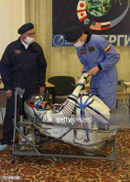 Wearing his space suits a crew member of the next expedition to the International Space Station Russian cosmonaut Roman Romanenko takes part in the...