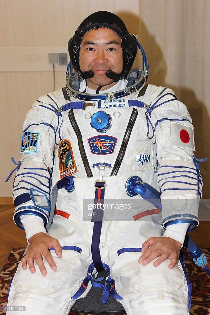 Wearing his space suits Japanese astronaut <a gi-track='captionPersonalityLinkClicked' href=/galleries/search?phrase=Akihiko+Hoshide&family=editorial&specificpeople=5329772 ng-click='$event.stopPropagation()'>Akihiko Hoshide</a>, a crew member of the next expedition to the International Space Station, smiles as he prepares to take part in a pre-flight training at the Kazakhstan's Baikonur cosmodrome on July 3, 2012. The launch of the next ISS crew including US astronaut Sunita Williams, Russian cosmonaut Yuri Malenchenko and Japanese astronaut <a gi-track='captionPersonalityLinkClicked' href=/galleries/search?phrase=Akihiko+Hoshide&family=editorial&specificpeople=5329772 ng-click='$event.stopPropagation()'>Akihiko Hoshide</a> is scheduled on July 15. AFP PHOTO