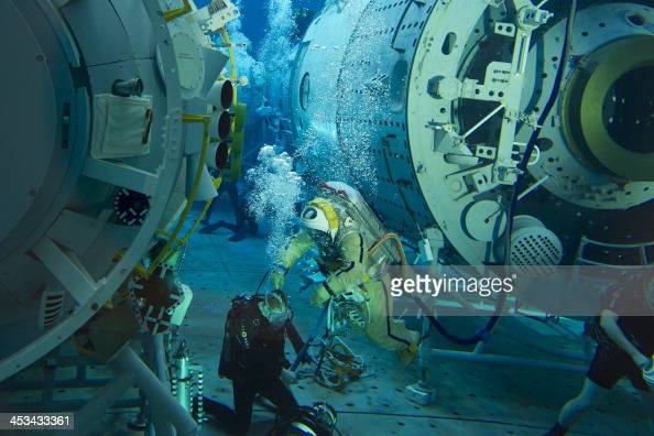 Wearing his spacesuit Russian cosmonaut Oleg Artemyev takes part in a preflight underwater training session in a pool at the Gagarin Cosmonauts'...