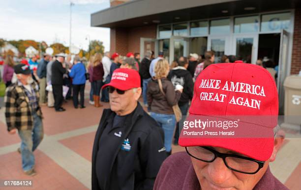 Wearing Make America Great Again hats Richard Theriault of Bangor right and his father Paul Thriault of Fort Kent wait to enter the Cross Insurance...