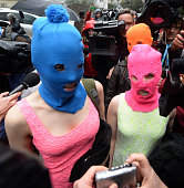 Wearing masks members of Russian punk group Pussy Riot Nadezhda Tolokonnikova and Maria Alyokhina speak to journalists while leaving the police...