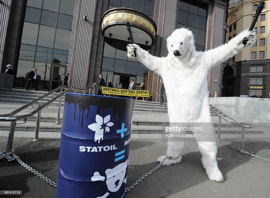 Wearing polar bear costumes a Greenpeace activist takes part in a staged show against Norwegian oil and gas group Statoil's planned drilling in the...