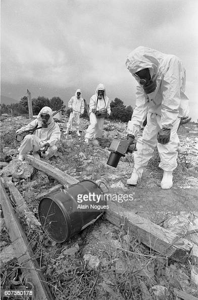Wearing protective suits members of the Cellule Mobile d'Intervention Radiologique unit of French firefighters test the ground for radioactivity...