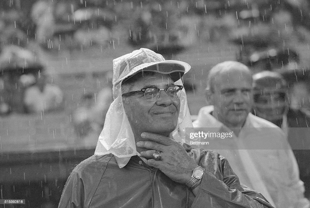 Wearing rain gear against a heavy thunderstorm Vince Lombardi new head coach of the Washington Redskins watches his team play the Chicago Bears in an...