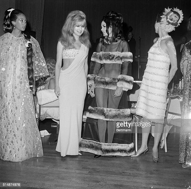Wearing Shakespeareanstyled gown actress Pamela Tiffin and Gloria Steinem frolic at Bard's benefit ball here late June 13 Miss Tiffin is dressed as...