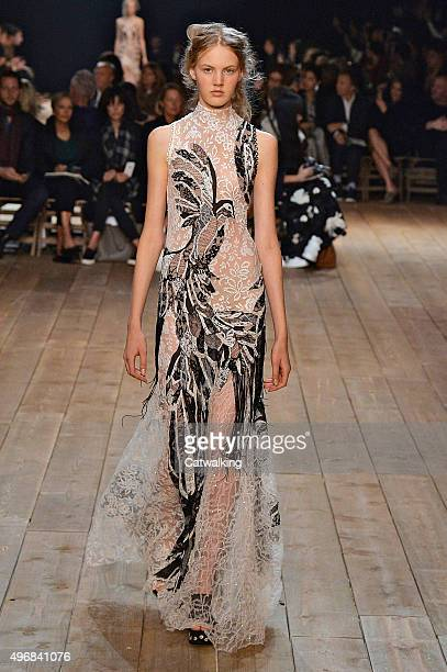 Wearing the latest lacey fabric trend a model walks the Alexander McQueen fashion show runway at the spring summer 2016 women's readytowear fashion...