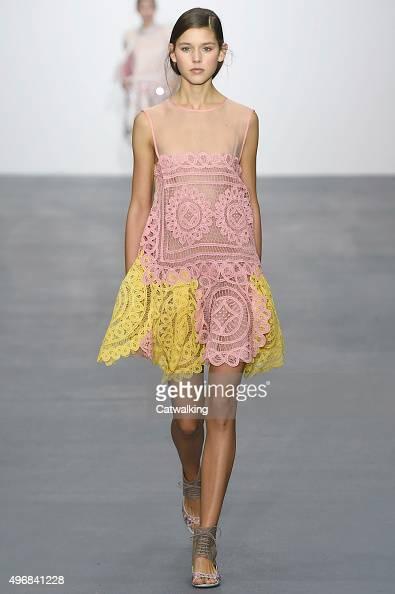Wearing the latest lacey fabric trend a model walks the Bora Aksu fashion show runway at the spring summer 2016 women's readytowear fashion weeks...