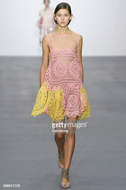 Wearing the latest lacey fabric trend a model walks the Bora Aksu fashion show runway at the spring summer 2016 women's readytowear fashion weeks...