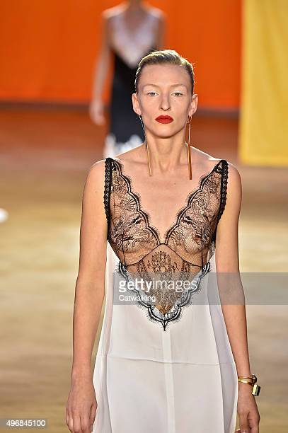 Wearing the latest lacey fabric trend a model walks the Celine fashion show runway at the spring summer 2016 women's readytowear fashion weeks during...