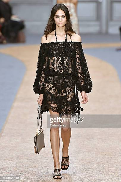 Wearing the latest lacey fabric trend a model walks the Chloe fashion show runway at the spring summer 2016 women's readytowear fashion weeks during...