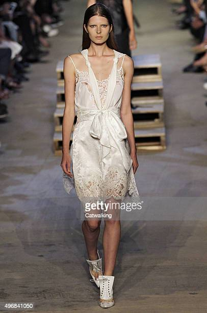 Wearing the latest lacey fabric trend a model walks the Givenchy fashion show runway at the spring summer 2016 women's readytowear fashion weeks...