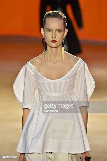 Wearing the latest shapewear lingerie look trend a model walks the Celine fashion show runway at the spring summer 2016 women's readytowear fashion...