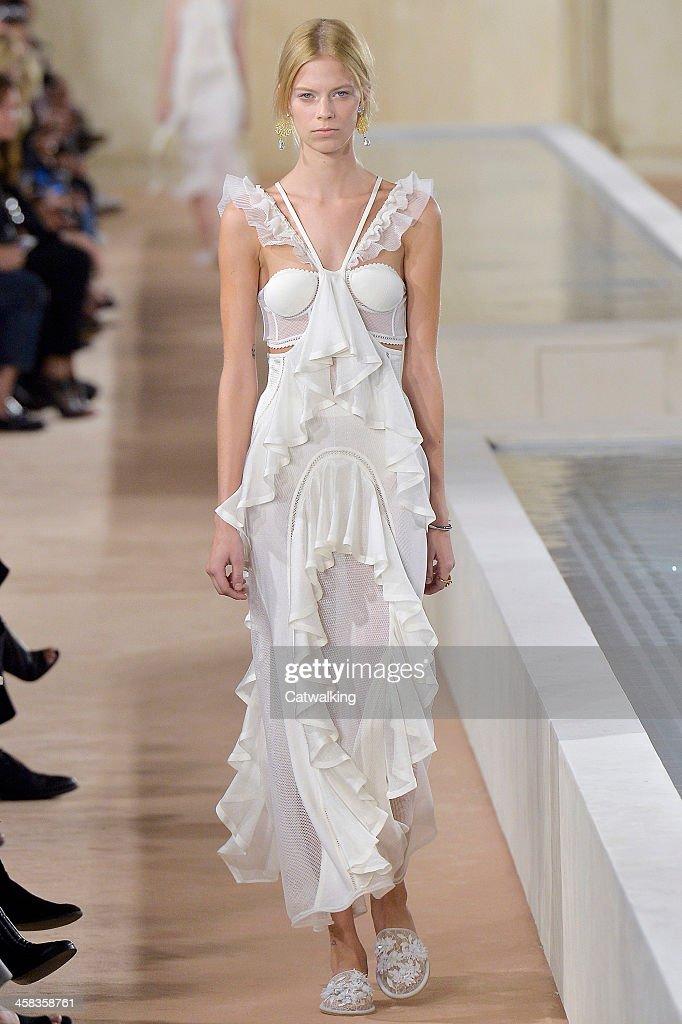 Wearing the latest slip lingerie trend a model walks the Balenciaga fashion show runway at the spring summer 2016 women's readytowear fashion weeks...
