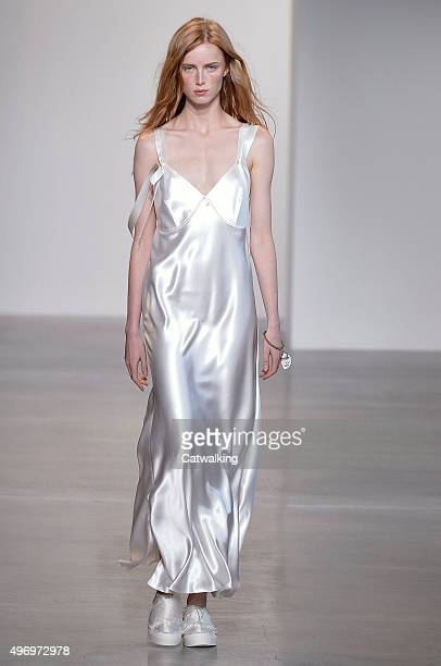 Wearing the latest slip lingerie trend a model walks the Calvin Klein fashion show runway at the spring summer 2016 women's readytowear fashion weeks...