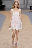 Wearing the latest slip lingerie trend a model walks the Chloe fashion show runway at the spring summer 2016 women's readytowear fashion weeks during...