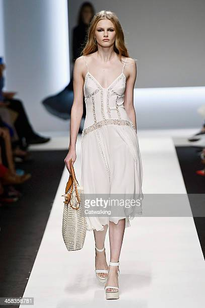 Wearing the latest slip lingerie trend a model walks the Ermanno Scervino fashion show runway at the spring summer 2016 women's readytowear fashion...
