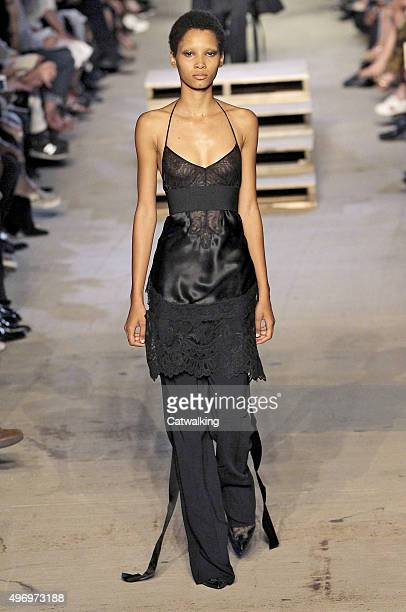 Wearing the latest slip lingerie trend a model walks the Givenchy fashion show runway at the spring summer 2016 women's readytowear fashion weeks...