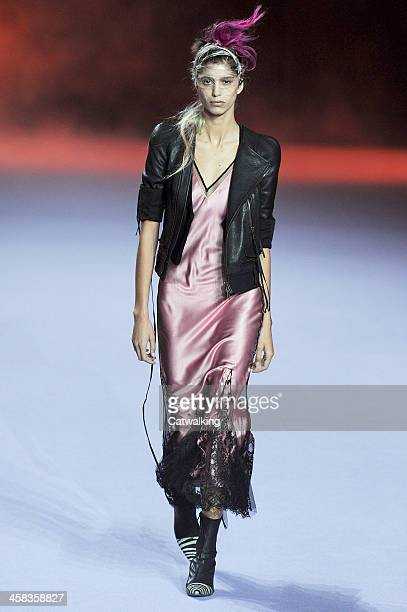 Wearing the latest slip lingerie trend a model walks the Haider Ackermann fashion show runway at the spring summer 2016 women's readytowear fashion...