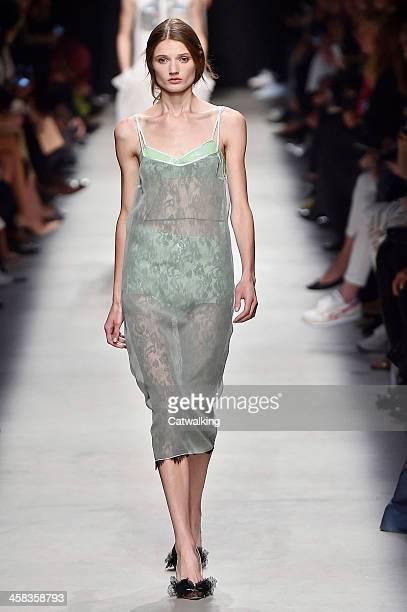 Wearing the latest slip lingerie trend a model walks the Rochas fashion show runway at the spring summer 2016 women's readytowear fashion weeks...