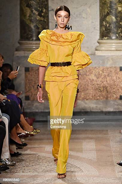 Wearing the latest yellow color trend a model walks the Blugirl fashion show runway at the spring summer 2016 women's readytowear fashion weeks...