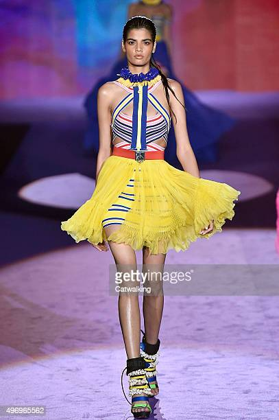 Wearing the latest yellow color trend a model walks the DSquared2 fashion show runway at the spring summer 2016 women's readytowear fashion weeks...