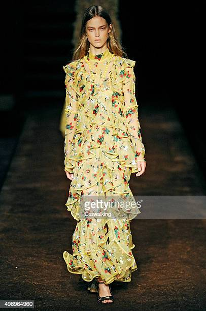 Wearing the latest yellow color trend a model walks the Erdem fashion show runway at the spring summer 2016 women's readytowear fashion weeks during...