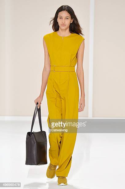 Wearing the latest yellow color trend a model walks the Hermes fashion show runway at the spring summer 2016 women's readytowear fashion weeks during...