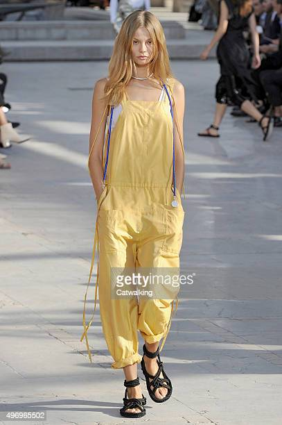 Wearing the latest yellow color trend a model walks the Isabel Marant fashion show runway at the spring summer 2016 women's readytowear fashion weeks...