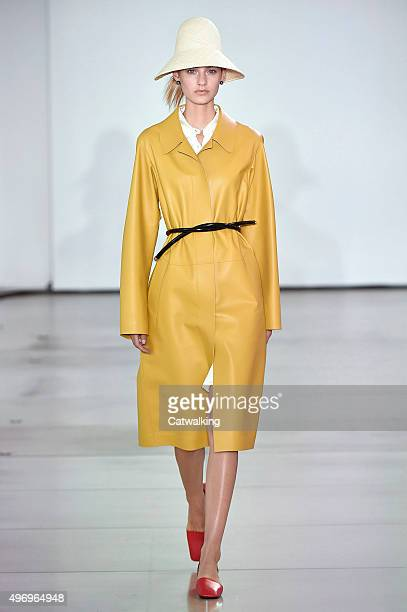 Wearing the latest yellow color trend a model walks the Jil Sander fashion show runway at the spring summer 2016 women's readytowear fashion weeks...