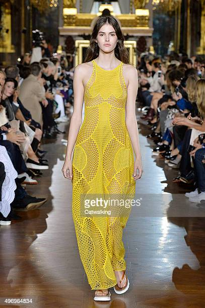 Wearing the latest yellow color trend a model walks the Stella McCartney fashion show runway at the spring summer 2016 women's readytowear fashion...