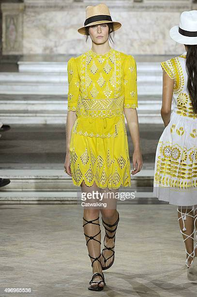 Wearing the latest yellow color trend a model walks the Temperley London fashion show runway at the spring summer 2016 women's readytowear fashion...