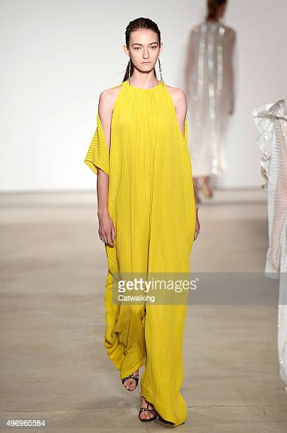 Wearing the latest yellow color trend a model walks the Tome fashion show runway at the spring summer 2016 women's readytowear fashion weeks during...