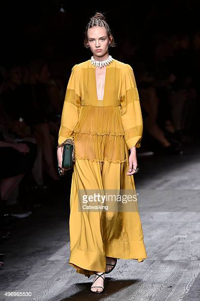 Wearing the latest yellow color trend a model walks the Valentino fashion show runway at the spring summer 2016 women's readytowear fashion weeks...