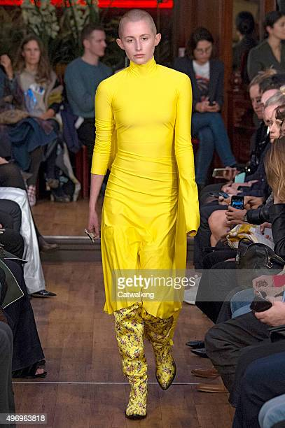 Wearing the latest yellow color trend a model walks the Vetements fashion show runway at the spring summer 2016 women's readytowear fashion weeks...