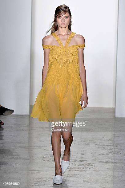 Wearing the latest yellow color trend a model walks the Wes Gordon fashion show runway at the spring summer 2016 women's readytowear fashion weeks...