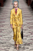 Wearing the latest yellow color trend model Ruth Bell walks the Gucci fashion show runway at the spring summer 2016 women's readytowear fashion weeks...