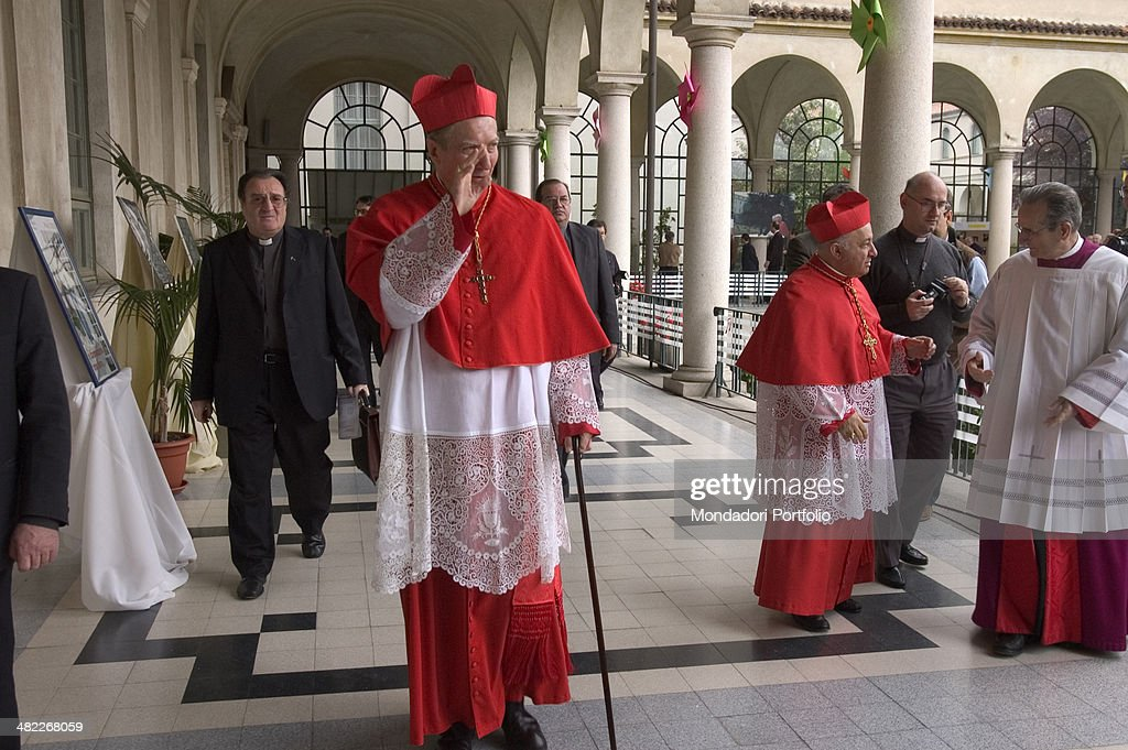 Wearing the typical scarlet garments Carlo Maria Martini Archbishop of Milan from 1979 to 2002 walks along the cloister of a seminary greeting...