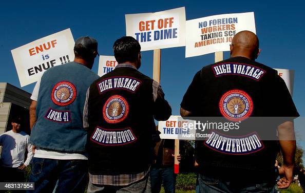 Wearing their 'High Voltage' union vests some of the more than 500 members of the International Brotherhood of Electrical Workers walk the picket...