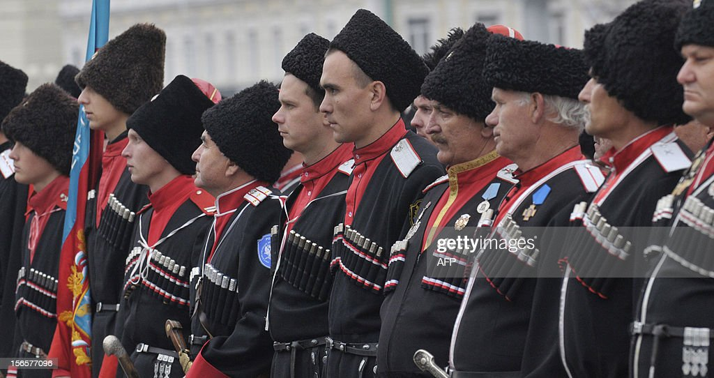 Wearing their traditional costumes Cossack gather for the regional Cossack community's inspection in the southern Russian city of Stavropol, on on November 17, 2012. Cossacks were mounted peasant-soldiers, who by the late 18th century became a privileged military class in Russia. There were 11 Cossack communities, each named for its location.