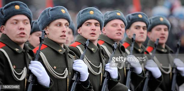 DERMY wearing their traditional Ushanka winter hats Russian soldiers march during a military parade marking the 70th anniversary of the Stalingrad...