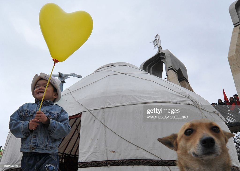 Wearing traditional Kyrgyz hat a boy holds a balloon during the celebrations of Nowruz (New Year) in the Kyrgyzstan's capital Bishkek on March 21, 2013. Nowruz, 'The New Year' in Farsi, is an ancient festival marking the first day of spring in Central Asia.