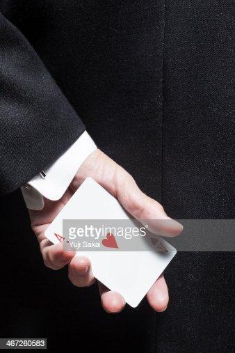 wearing Tuxedo  man holding  Hart A
